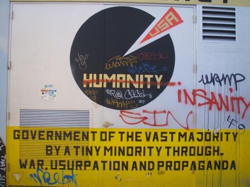 I love political graffiti--bar code and pie chart